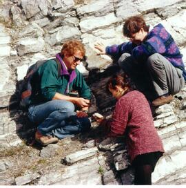 Promotional photograph of Geology (?) students and faculty