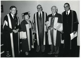 President Beckel (left) and Hilda Gifford (second from left) at Convocation