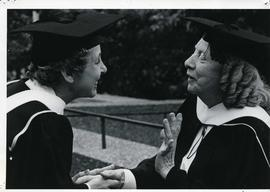 A graduate with a Master of Arts (English) being congratulated by a classmate (1979 convocation).  Florence Reid (left).