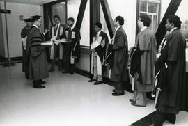 Students line up outside the cobatives room-  Spring convocation 1986