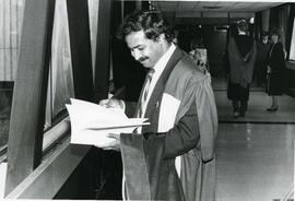 Convocation graduate reading program outside of the combatives room - Spring convocation 1986