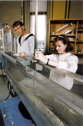 Promotional photograph of two students conducting an experiment