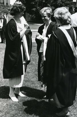 Convocation scene of three women graduates - Spring 1986