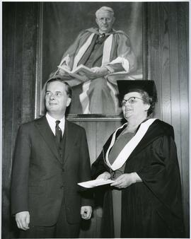 President Dunton and Mrs Mary Etta Hill standing infrom of Tory's portrait - November 1, 1962