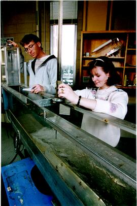 Promotional photograph of two students in a lab / workshop