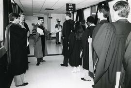 Convocation student lining up outside the combatives room  - Spring convocation 1986