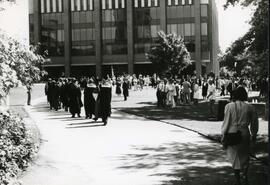 [Convocation graduates and audience, congregating outside Robertson Hall] - Spring 1986