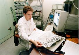 Promotional photograph of a neuroscience student in a lab