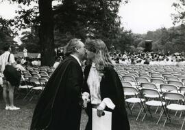 Congratulatory kiss between convocation graduates, Spring 1986