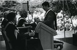 Chancellor Gordon Robertson conferring with a RCMP convocation graduate Spring 1986