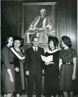President Dunton with Mrs. Hill [and family], Mrs. Betcheman [and family] posing in front of Tory...