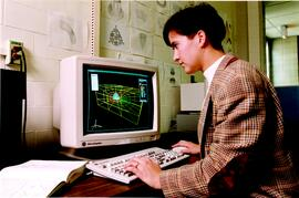 Promotional photograph of a student working at a computer