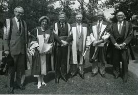 G. Robertson, President Beckel and Ph.D. graduates
