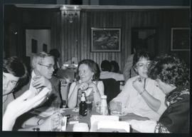 Six unidentified adults around a dinner table. El Salvador, ca. 1986.