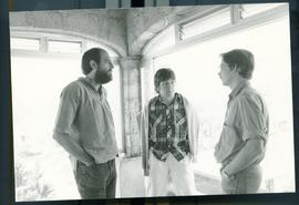Three unidentified people speaking on a porch or in a room with large windows. Mission For Peace ...