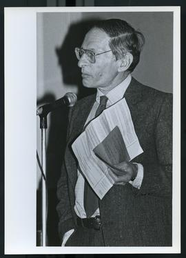 Bruce Meyer speaking at a microphone.