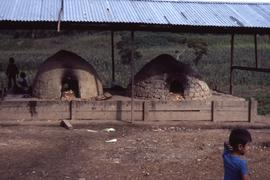Baking ovens. Traditional ovens fueled by wood harvested by refugees. Mesa Grande, Honduras, ca. ...