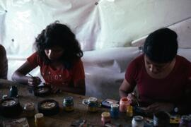 Workshop painting souvenirs - usually scenes of Salvador but some of camp experience. Colomancagu...