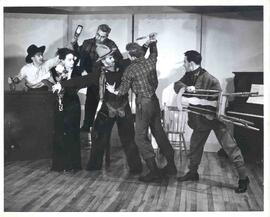 "A scene from ""The Shooting of Dan McGrew"". In the scene from left to right is John Perd..."