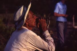 An elder looking towards El Salvador. He told Meyer Brownstone that he sat here every evening thinking about the past and about his return - he had never lost hope. Grande Mesa, Honduras, ca. 1985.