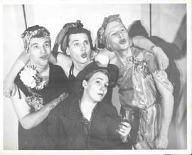 Three male actors posing as female back up singers and one female actress posing as Bing Crosby i...