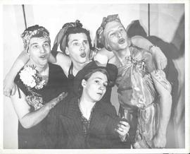 Three male actors posing as female back up singers and one female actress posing as Bing Crosby in a group photo for Sock N' Buskin. The actors are left to righ Bill Riseboroug, John Derewery (later to become Canada's air gunner ace), John Lewis and Pauline Steeves.