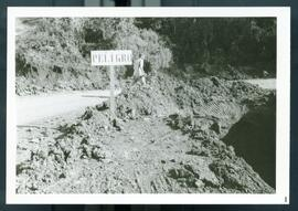A road sign warning of danger (peligro) ahead on the road. Honduras, ca. 1982.