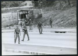 Army patrol pursuing Inkatha who were attacking outside of the stadium. South Africa, 1994.