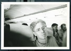 Bruce Cockburn on an airplane. Honduras, ca. 1985.