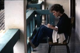 Katherine Pearson Oxfam Staff at hotel making notes on visit to Colomancagua. Honduras, ca. 1985.