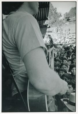 Bruce Cockburn performing at the Colomancagua refugee camp. Honduras, 1985.