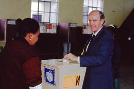 Democratic party member voting. South Africa, ca. 1994.