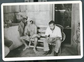 Two unidentified men sitting on a bench.
