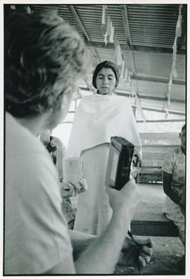 A refugee woman recording her story with Bruce Cockburn. Honduras, ca. 1985.