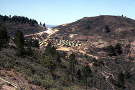 View of a small refugee camp on a plateau in an arid and cleared landscape. Honduras, ca. 1985.