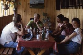Bruce Cockburn et al having a refreshment. Honduras, ca. 1985.