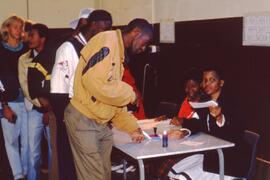 Voters registering after Mandela voted. South Africa, 1994.