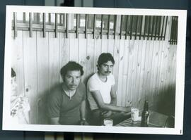 Two unidentified men drinking beer. Honduras, ca. 1985