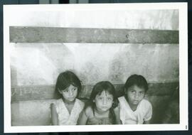 Three girls in a temporary shelter. Honduras, ca. 1985.
