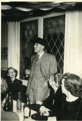Photo of W. Eggleston making a speech at dinner party, ca. 1966.