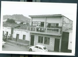 Three Adults on a balcony. Honduras, ca. 1985.