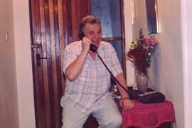 "Dave Barrett at work phoning news to Canada. As the mission's ""Chief correspondent"" Dav..."