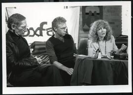 Meyer Brownstone, Bruce Cockburn, and an unidentified female Oxfam Canada member at a new confere...