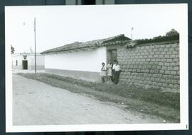 Four children standing by a wall. Honduras, ca. 1985