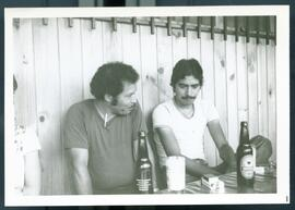 Two unidentified men drinking beer. Honduras, ca. 1985.