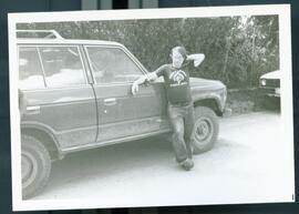 An unidentified man leaning on a truck. Honduras, ca. 1985