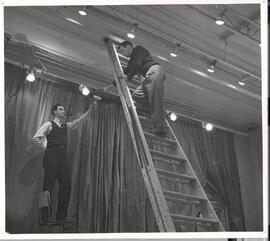 Picture of Bill Milks, Lighting and John Urquhart, stage manager, setting up the stage lights for...