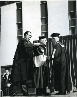 Prof. Wernham, Vincent Massey (receiving his Academic hood) and the Chancellor, 1963.