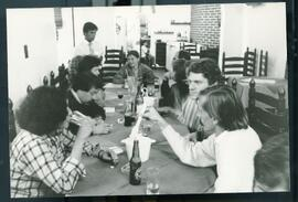A group of some ten people sitting around a table at a restaurant. Mission For Peace in El Salvador (1986-87). I cannot recall the name of one of the members. She was from Quebec. The others were Meyer Brownstone Head of mission, General Leonard Johnson (retired), Dr. John Savage, mayor of Dartmouth Nova Scotia and later Premier of Nova Scotia, and Nancy Thede an anthropologist from McGill who also served as an interpreter for the member whose name I have forgotten but who was either a trade unionist or a human rights activist. Her name can be found in the file b3 f 5 I believe which contains a report of the mission. This mission is a good example of Oxfam`s advocacy process and in this case engaging parliamentarians who provided excellent and credible reports to parliament and the press on their return to Canada. ( as well as offering to address public meetings organized by Oxfam.