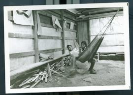 Two young girls in a hammock. Honduras, ca. 1985
